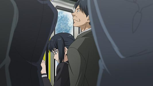 A salaryman gropes a high school girl in a train, example of chikan 痴漢.