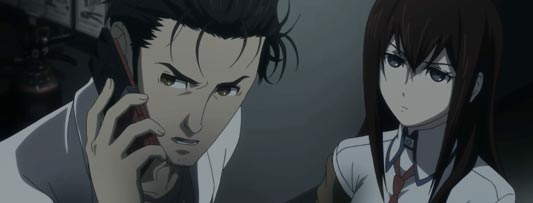 Okabe Rintaro 岡部倫太郎, on a cellphone turned off, reporting that he's been caught by an agent of the Organization, Makise Kurisu 牧瀬紅莉栖, example of chuunibyou 中二病.