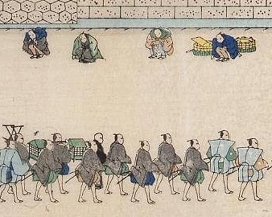A procession with people squatting before it. Example of dogeza 土下座.