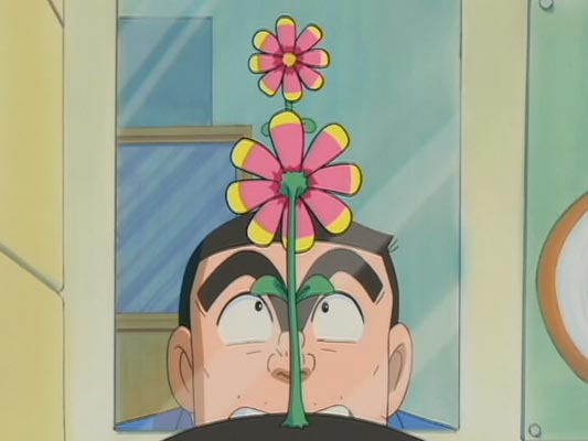 Ryoutsu Kankichi 両津勘吉, with a flower growing on his head.