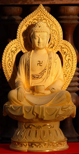 An image of Buddha featuring a swastika on his chest.